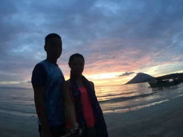 Sunset shadow of us and volcano in Bunaken.